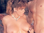 Retro porn brings cock to nipple rubbing with shots of semen dripping down her flat belly