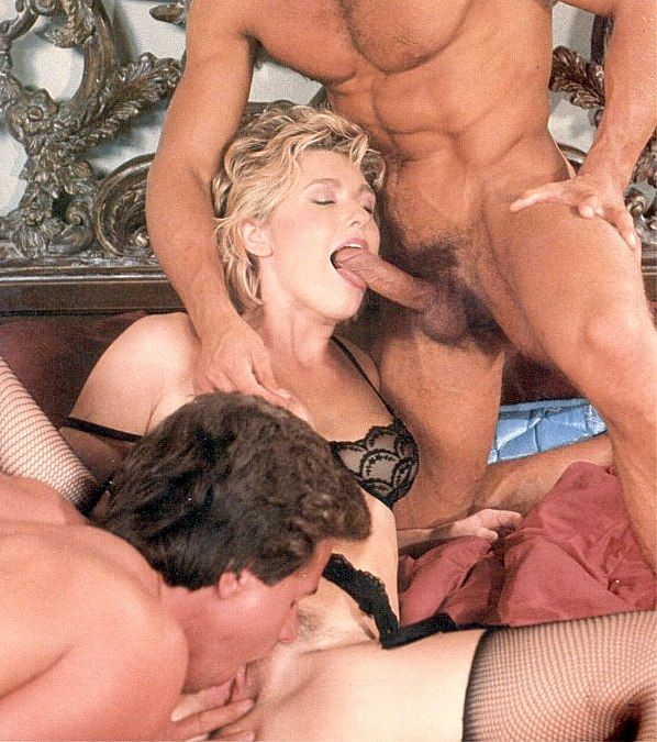 Dressed in black lace lingerie, blonde is getting the attention of dueling dicks in threesome