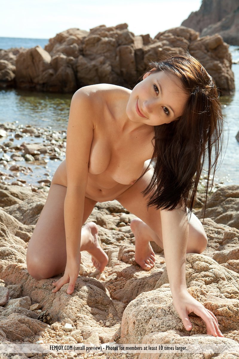 The playful side of this brunette shows combing the beaches is done in full nudity for her