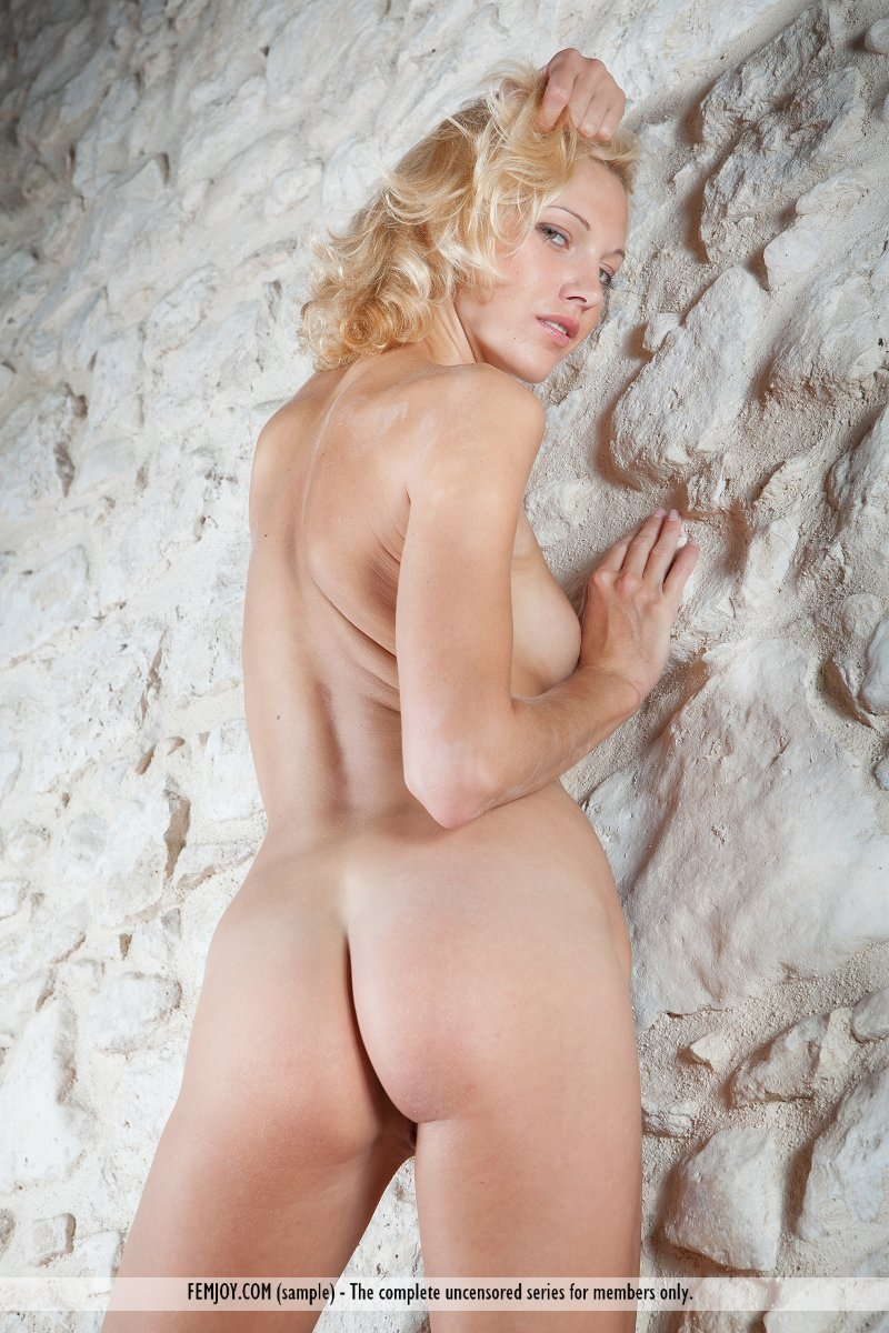 Blondes definitely have more fun, as this babe shows with hot nipples pressed against cool rocks