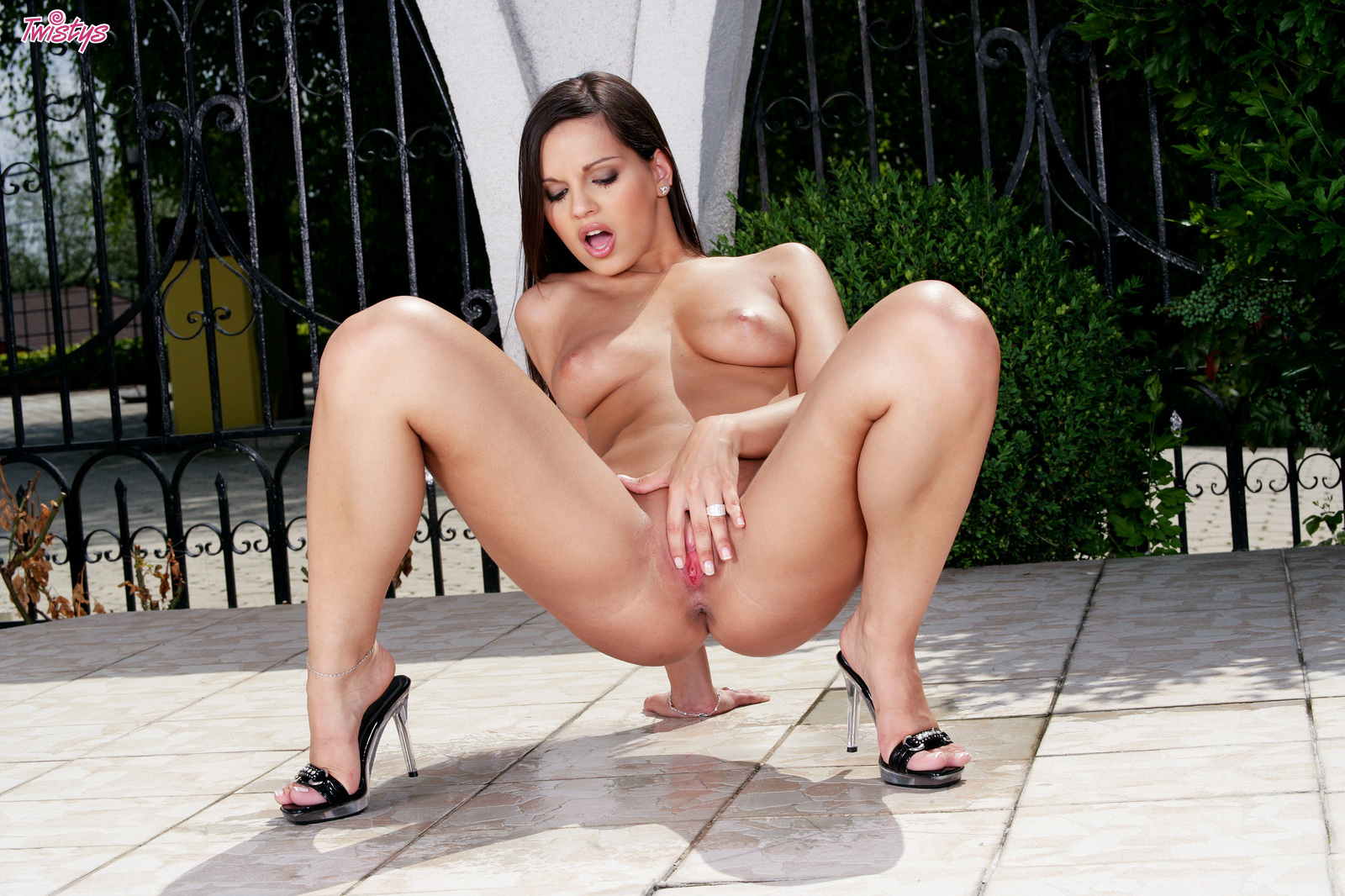 Stiletto heels and big boobs are the beginning of this brunette, spreading pussy for pink show