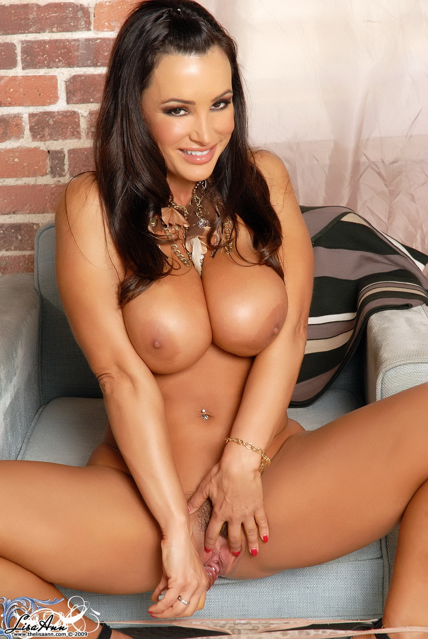 With good reason Lisa Ann flashes a wide smile, her glass dildo makes her happy