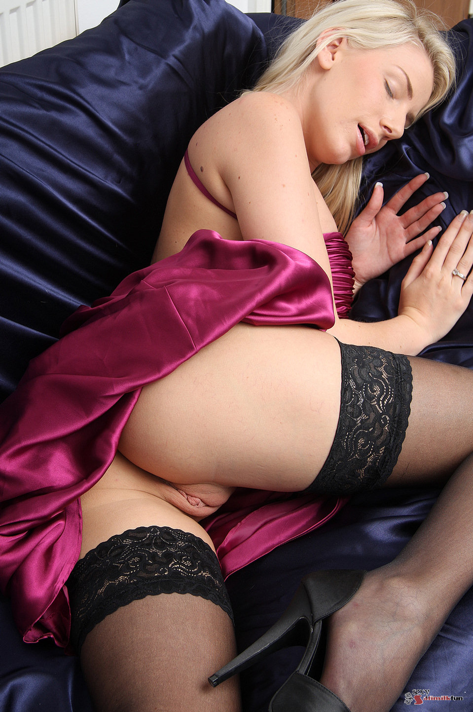 Blonde Danielle in black stockings and silk lingerie