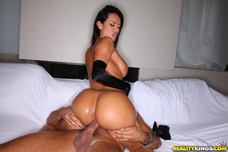 A full moon and swaying tits, this brunette rides an engorged cock aimed at her shapely ass